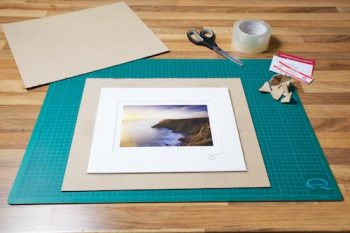 An image of a Matted print with all the materials I use to carefully package it before it's shipped to a customer. by John Dunne.