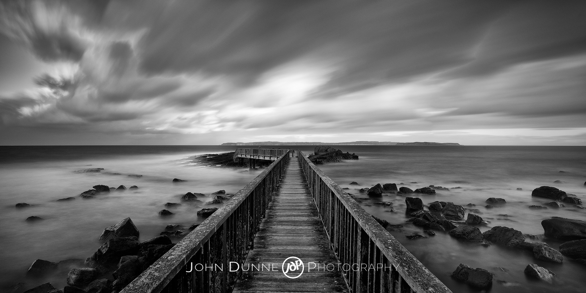 Morning's Light over Ballycastle - B&W, Clouds, Dark by .