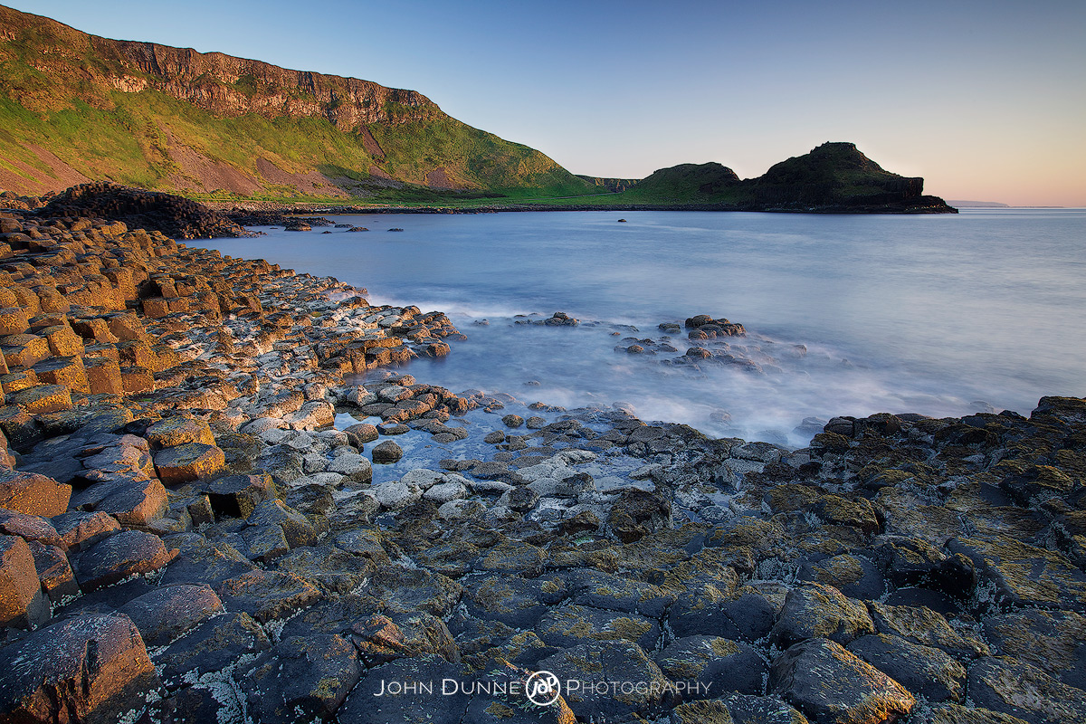 Sun sets upon the Giants Causeway by John Dunne.