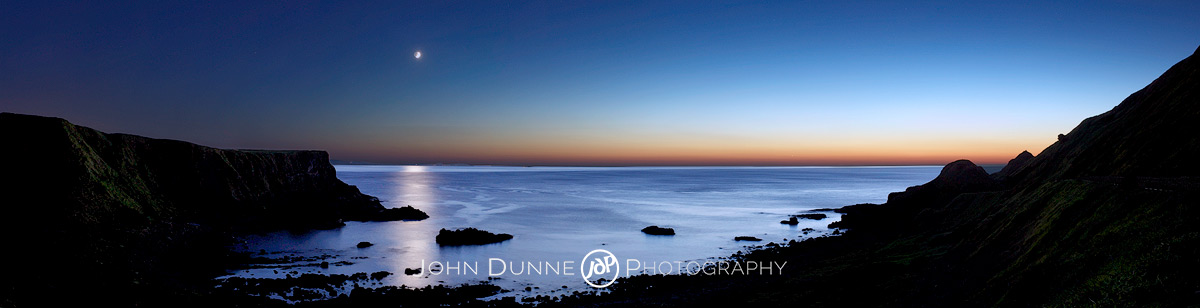 The Moon rises on an Antrim Coast by John Dunne.