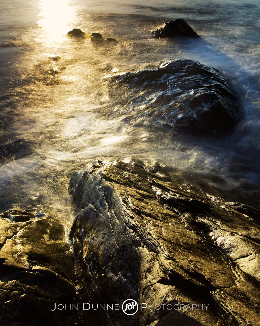 Waves Upon Rocks by John Dunne.