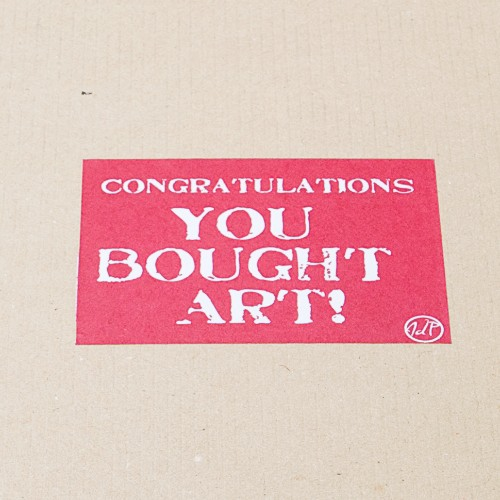 "An image of the ""Congratulations! You Bought Art"" Sticker placed on every John Dunne Photography Shipment by John Dunne."