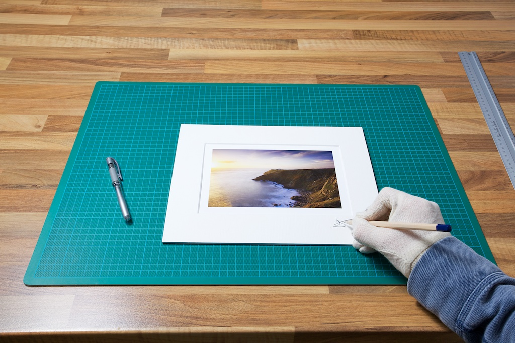 An image of me signing the Matte from one of my original Prints from John Dunne Photography by John Dunne.